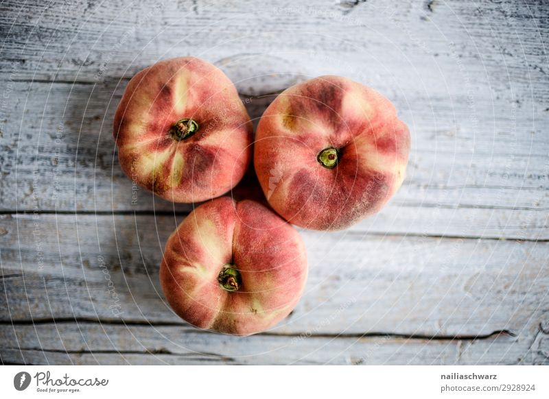 Three peaches Food Fruit Peach Nutrition Eating Organic produce Vegetarian diet Diet Snowboard Wood Fragrance Healthy Delicious Natural Juicy Sweet Yellow Gray