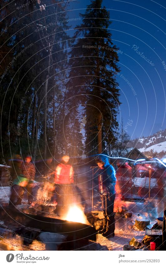 Human being Nature Winter Forest Cold Snow Movement Group Feasts & Celebrations Ice Contentment Stand Lifestyle Beautiful weather Elements Fire