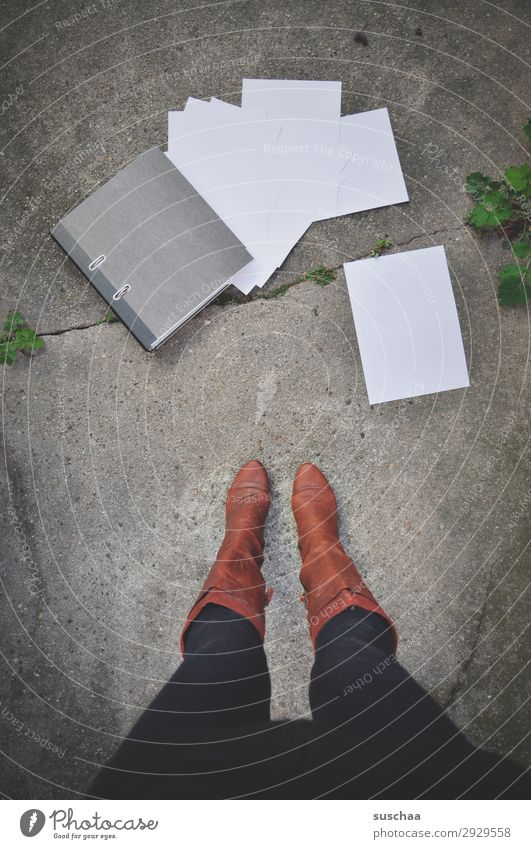 woman is standing on the street in front of a fallen file order with falling leaves Legs Woman Stand Boots feminine File Work and employment streetwork