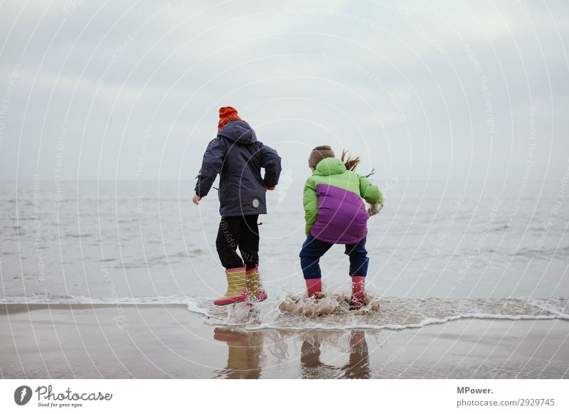 water fleas Human being Child Girl 2 8 - 13 years Infancy Nature Jump Parenting Ocean Playing Rubber boots Baltic Sea Bad weather Beach Romp Discover