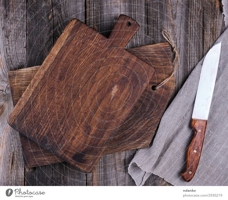 two old wooden cutting boards and a knife Knives Design Kitchen Wood Old Dirty Dark Natural Above Retro Brown Ancient background Blank chopping cooking empty