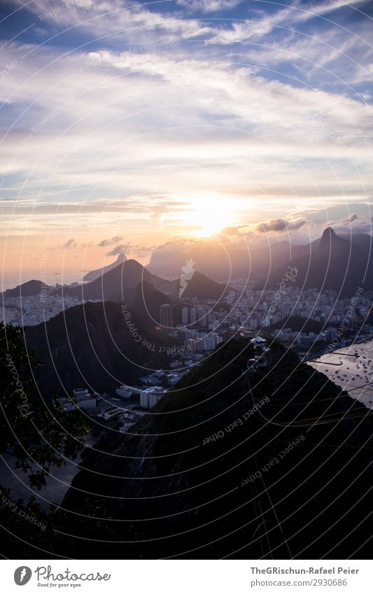 sugar mountains Environment Nature Blue Yellow Gold Violet Black Clouds Mountain Sunset Back-light Town City Rio de Janeiro Brazil House (Residential Structure)