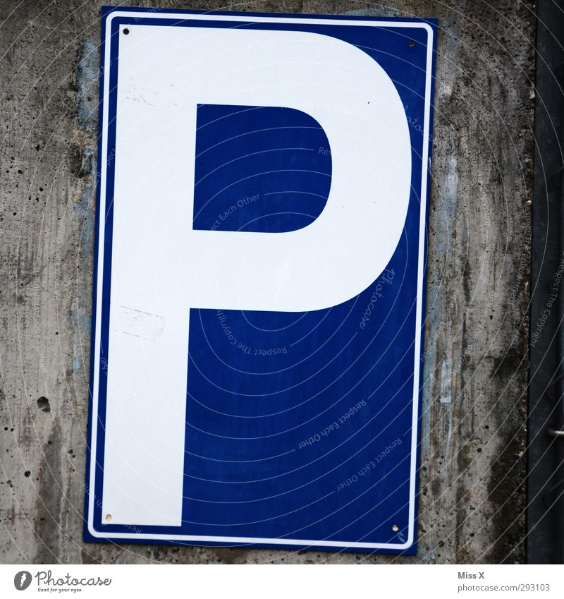 P Characters Signs and labeling Signage Warning sign Road sign Blue Parking lot Colour photo Exterior shot Close-up