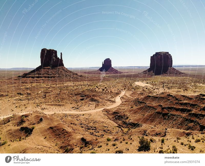 Monument Valley Environment Nature Landscape Elements Earth Sand Sky Cloudless sky Summer Beautiful weather Warmth Drought Bushes Rock Mountain Peak Canyon Blue