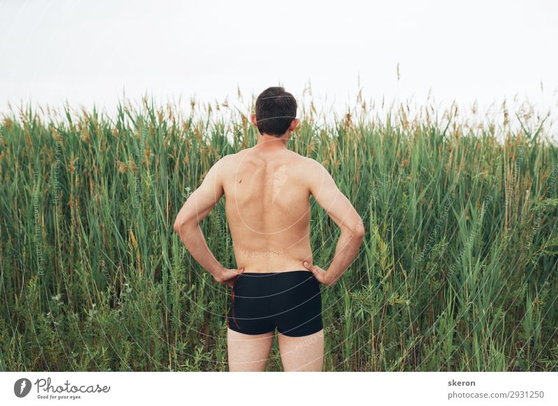 guy tourist in swimming trunks on the beach Human being Vacation & Travel Youth (Young adults) Man Summer Sun Ocean Eroticism Relaxation Far-off places Beach