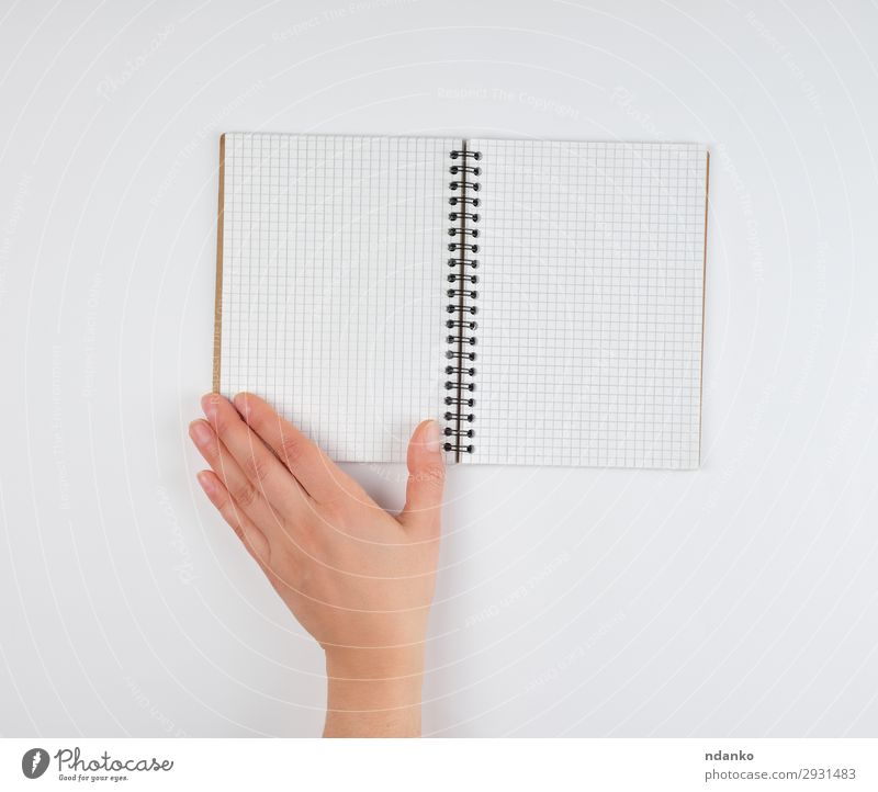 empty open notebook in a cell and a female hand School Study Office Business Human being Woman Adults Arm Hand Fingers Book Paper Write White background Blank
