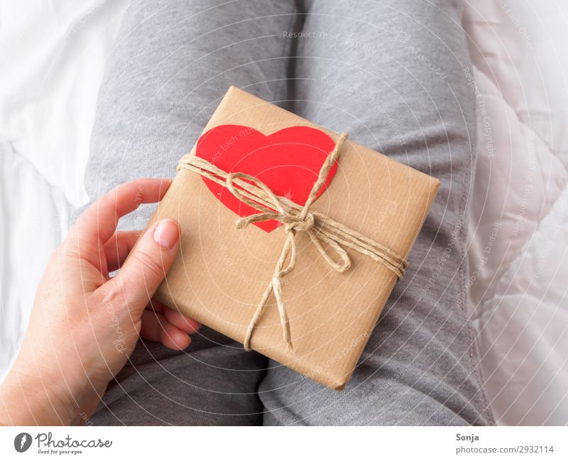 Woman with gift package with heart Mother's Day Birthday Feminine Adults Life Hand 1 Human being 45 - 60 years Packaging Package Heart Touch Anticipation