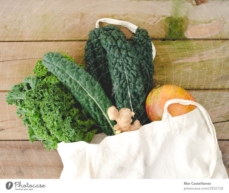 Cloth bag with vegetables on wooden background. Food Vegetable Fruit Soup Stew Nutrition Organic produce Vegetarian diet Diet Lifestyle Healthy Summer Table