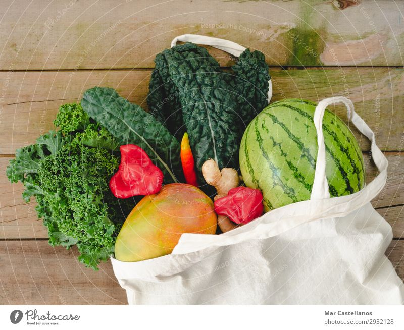 Cloth bag with vegetables on wooden background. Food Vegetable Fruit Nutrition Organic produce Vegetarian diet Diet Lifestyle Shopping Summer Table Kitchen Leaf