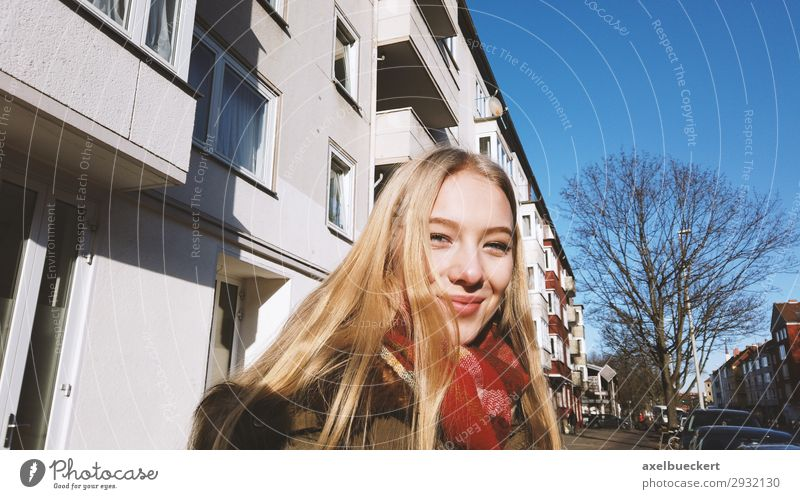 cheerful young woman on the street in winter Lifestyle Young woman Winter Youth (Young adults) Authentic Smiling City life Leisure and hobbies Human being