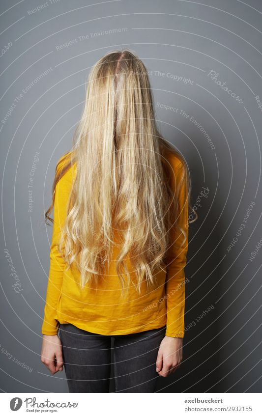 female teenager hiding behind long blond hair Human being Feminine Girl Young woman Youth (Young adults) Woman Adults 1 13 - 18 years 18 - 30 years