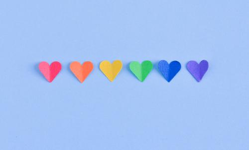 Row of hearts with GAY pride flag colors. Freedom Feasts & Celebrations Homosexual Woman Adults Man Couple Paper Heart Flag Love Sex Blue Yellow Green Violet
