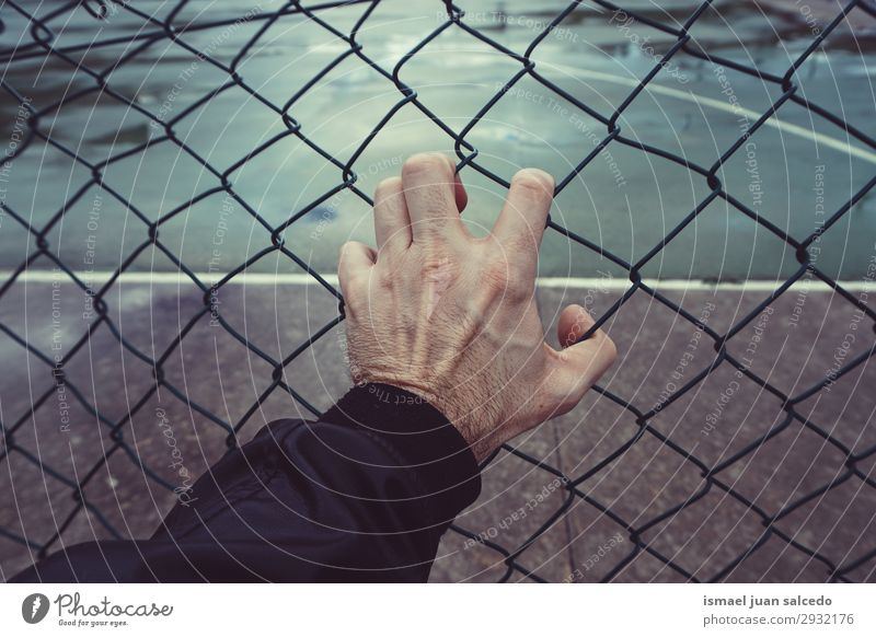 hand grabbing a metallic fence in the street Human being Man Hand Street Body Metal Arm Fingers Fence
