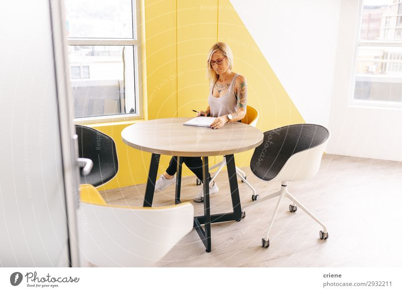 tattooed busy business woman writing notes in meeting room Beautiful Desk Chair Table Study Work and employment Profession Office Business Human being Woman