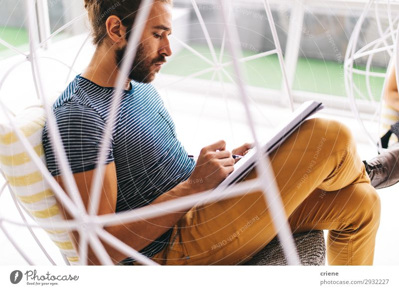 young business man concentrate on paperwork note person businessman writing chair office workplace pen schedule planner concept hand background male sit