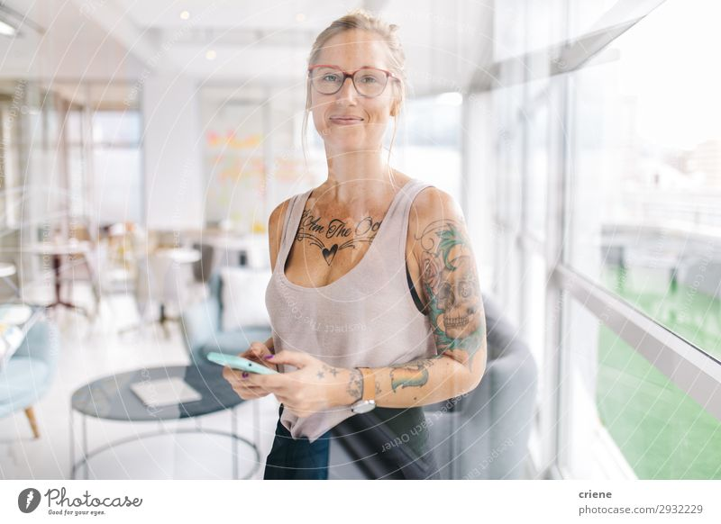 portrait of tattooed business woman Happy Beautiful Reading Work and employment Office Business Company Meeting Telephone PDA Technology Human being Woman