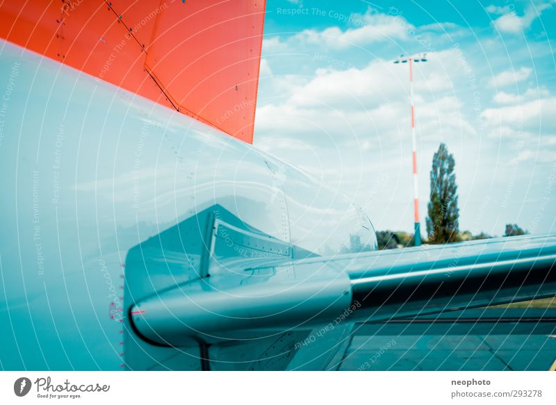 outboard Means of transport Aviation Airplane Passenger plane Airport Airfield Runway Blue Orange Sky Clouds elevator Tail Tree Colour photo Multicoloured