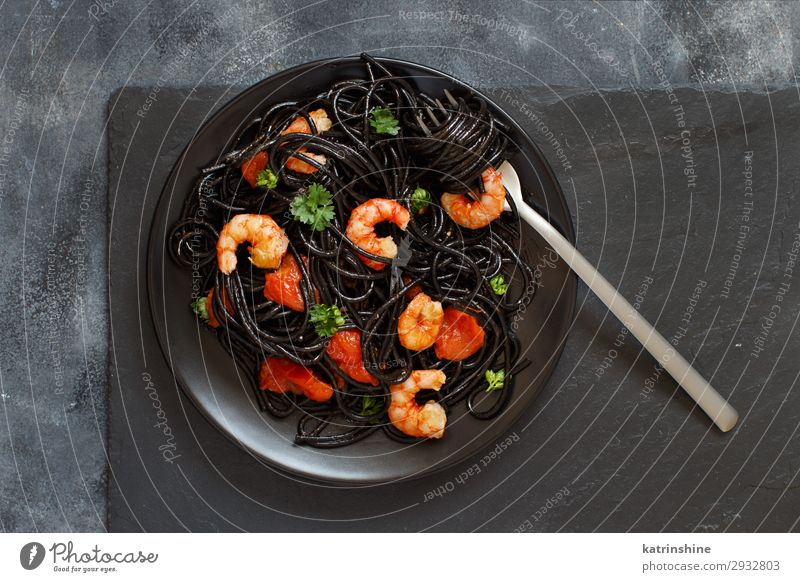 Squid ink pasta with prawns and tomatoes Seafood Eating Dinner Fork Delicious Black Spaghetti shrimp Tomato Italian Cooking Dish Parsley Portion knife Slate