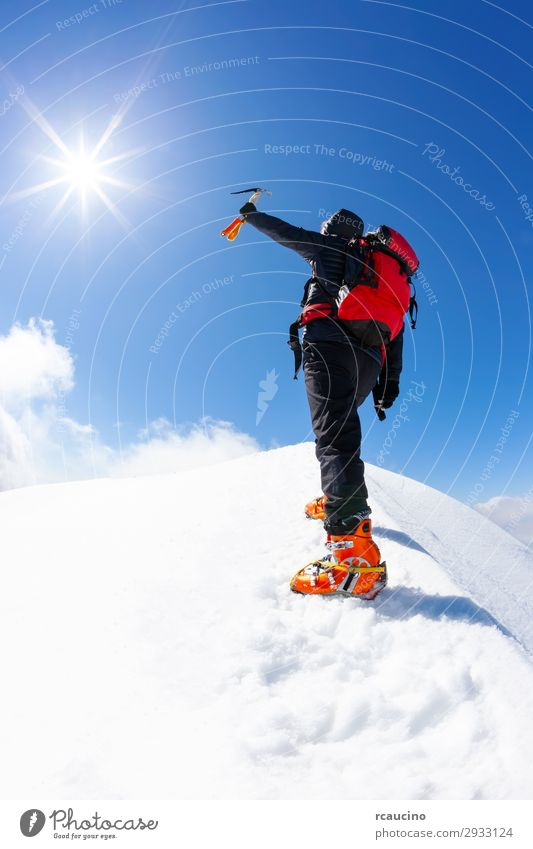 Climber reaches the summit of a snowy mountain Joy Vacation & Travel Adventure Freedom Expedition Sun Winter Snow Mountain Hiking Sports Climbing Mountaineering