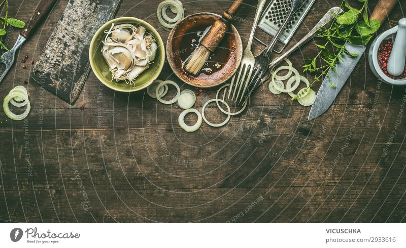 Kitchen utensils on rustic wooden background with fresh seasoning, BBQ simple marinade, top view. Copy space. kitchen bbq copy space barbecue steakhouse