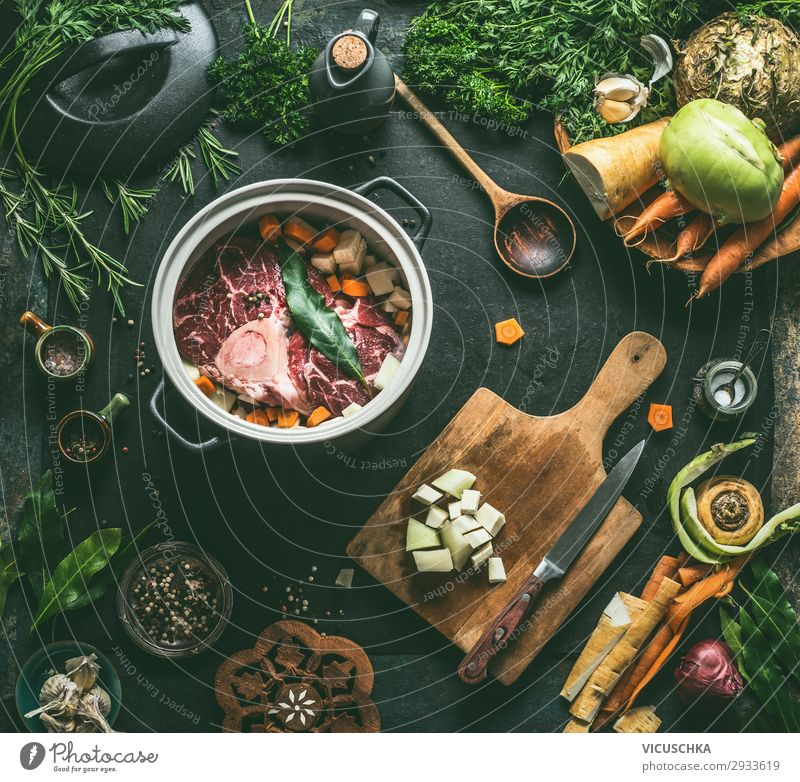 Preparing beef broth or soup Food Meat Vegetable Soup Stew Herbs and spices Nutrition Organic produce Vegetarian diet Diet Slow food Crockery Pot Knives Spoon