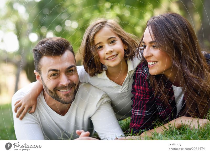 Happy young family in a urban park Lifestyle Joy Beautiful Summer Child Human being Girl Young woman Youth (Young adults) Young man Woman Adults Man Parents