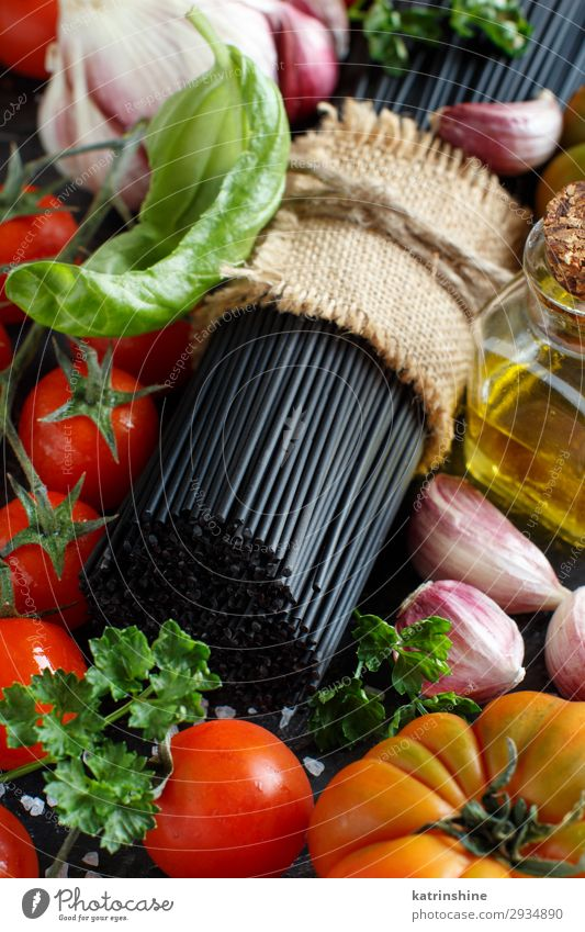 Raw squid ink pasta and vegetables Vegetable Modern Green Red Black White Squid ink Spaghetti Italian Tomato cherry tomatoes Ingredients Basil Garlic oil
