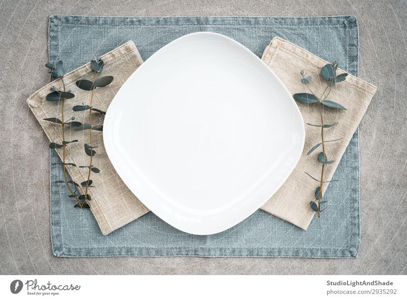 Elegant table setting decorated with eucalyptus branches Dinner Plate Style Design Interior design Table Kitchen Restaurant Plant Leaf Cloth Stone Concrete