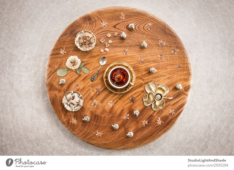 Round wooden table with tea and flowers Dessert Candy Beverage Tea Plate Spoon Design Table Flower Leaf Concrete Wood Metal Natural Retro Brown Gold Colour