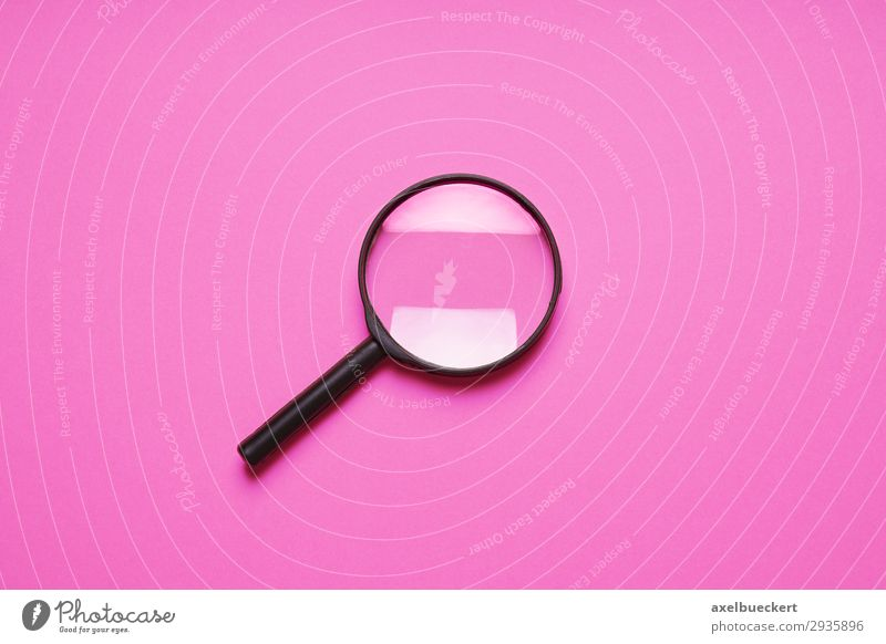Magnifying glass on pink background Sign Observe Pink Zoom effect Background picture Minimalistic Search Detective Enlarged Colour photo Interior shot