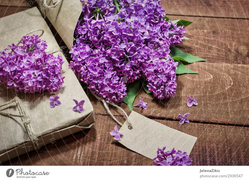 Gift and bouquet of lilacs on a wooden table Old Christmas & Advent Summer Beautiful Flower Adults Wood Love Blossom Spring Natural Feasts & Celebrations