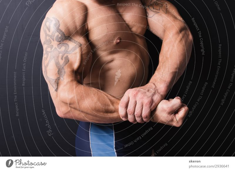 hand a powerful bodybuilder with a tattoo Lifestyle Healthy Leisure and hobbies Night life Entertainment Party Event Sports Fitness Sports Training Sportsperson