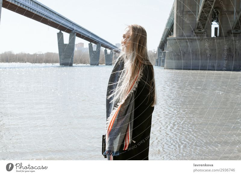 portrait of female on a beach with flying hair Vacation & Travel Blonde City Bridge Beach Cold Hair Weather Scarf Coat Spring Lifestyle Summer Ocean Young woman