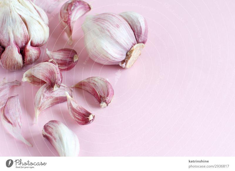Fresh garlic on a light pink background Copy Space Herbs and spices Vegetable Decline Vegetarian diet Conceptual design Raw Organic Minimal Garlic Clove