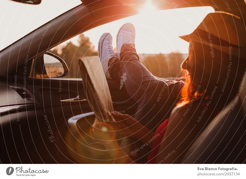 Modern girl resting in a car at sunset Lifestyle Joy Relaxation Reading Vacation & Travel Trip Adventure Summer Sun Feminine Young woman Youth (Young adults)