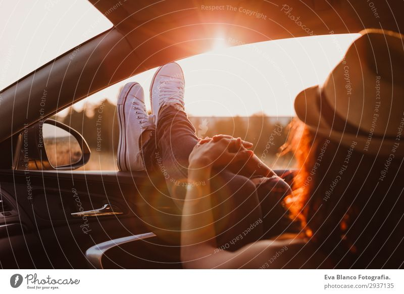 Modern girl resting in a car at sunset Lifestyle Joy Relaxation Vacation & Travel Trip Adventure Summer Sun Feminine Young woman Youth (Young adults) Woman
