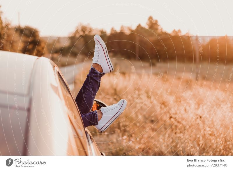Modern girl resting in a car and admiring view Lifestyle Joy Relaxation Vacation & Travel Trip Adventure Summer Sun Feminine Young woman Youth (Young adults)