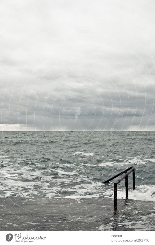 Forty foot Nature Sky Clouds Bad weather Storm Fog Waves Coast Ocean Dark Cold Swimming & Bathing Gray Handrail Concrete Horizon Water Dublin Colour photo
