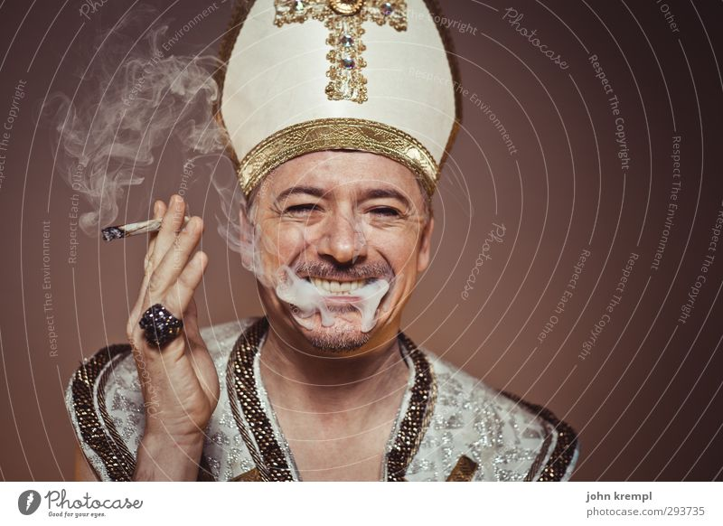 John Popel Man Adults 1 Human being 45 - 60 years Ring Hat mitre Crucifix Laughter Smoking Famousness Cool (slang) Happiness Hip & trendy Historic Trashy Gold