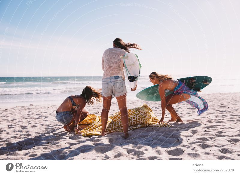 Friends hanging out on the beach enjoying summer vacation Lifestyle Joy Leisure and hobbies Vacation & Travel Summer Beach Friendship Sand Happiness Together