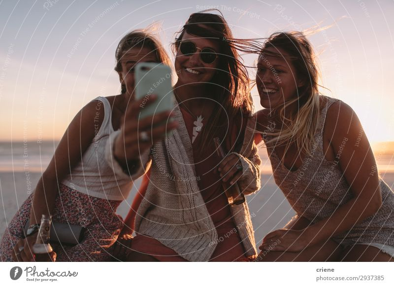Group of friends taking selfie with phone on beach party Lifestyle Joy Happy Vacation & Travel Summer Telephone Technology Friendship Sunglasses To enjoy