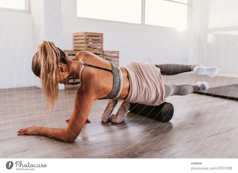 Woman using foam roller in the gym Lifestyle Style Beautiful Body Sports Yoga Adults Fitness Sit Athletic Thin Bright Power Concentrate fasciae Practice Home up