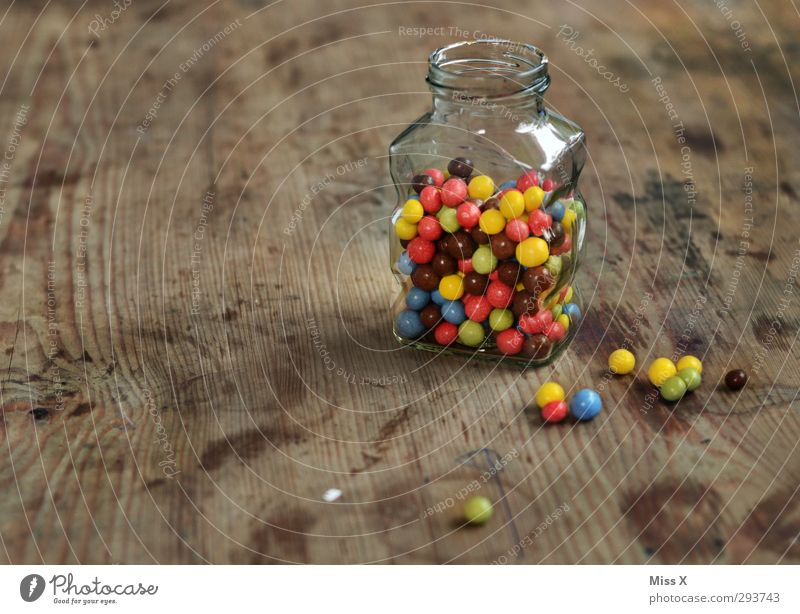 candy jar Food Candy Chocolate Nutrition Small Delicious Round Sweet Multicoloured Chocolate buttons Wooden table Glass Containers and vessels Keep Ingredients