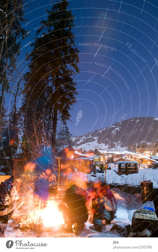 warming fire Life Trip Winter Snow Mountain Night life Feasts & Celebrations Human being Group Nature Fire Air Night sky Stars Beautiful weather Saanenland