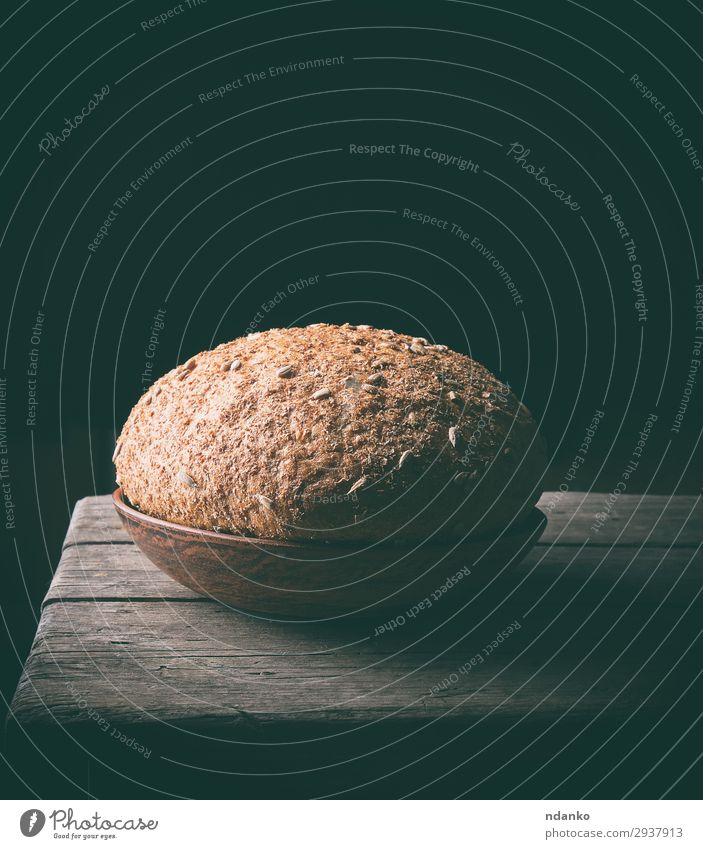 rye-bread bread with sunflower seeds Bread Eating Breakfast Diet Plate Wood Dark Fresh Delicious Natural Brown Tradition Rustic vintage Rye round loaf food