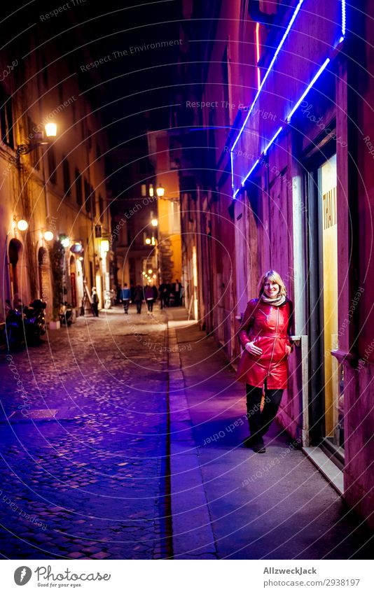 young woman at night in the neon light of the city center of Rome Europe Italy Town City Vacation & Travel Travel photography Blue sky Clouds Young woman Red