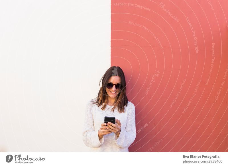 beautiful young woman using mobile phone and smiling Lifestyle Happy Beautiful Face Summer Work and employment Profession Telephone PDA Technology Human being