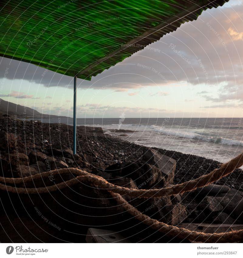 Sky Vacation & Travel Green Water Sun Ocean Landscape Calm Beach Far-off places Freedom Coast Stone Sand Air Horizon