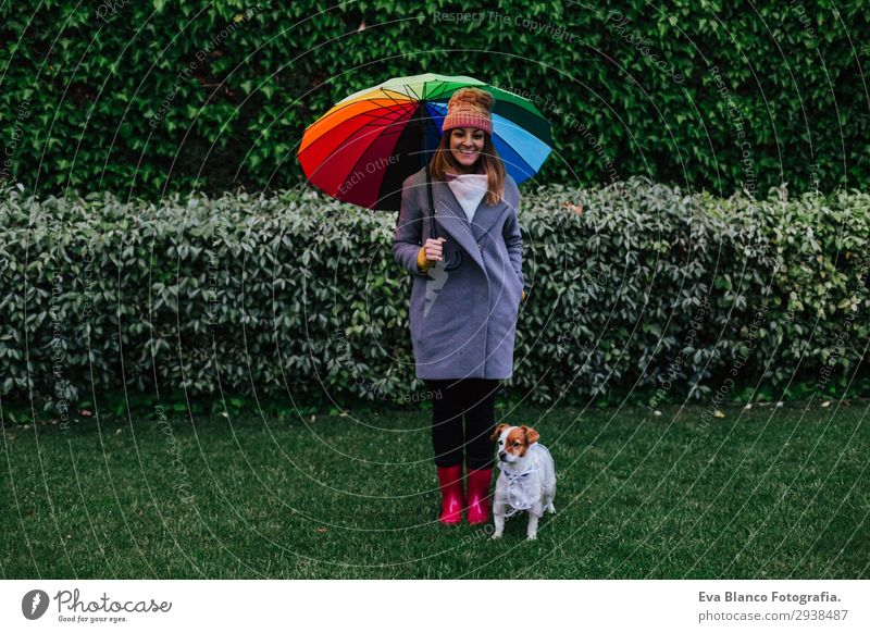 young woman and dog with umbrella outdoors Woman Human being Nature Dog Youth (Young adults) Young woman Water Clouds Animal Joy Lifestyle Adults Autumn Spring