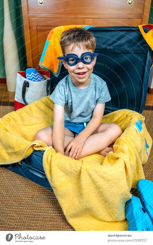 Funny boy smiling sitting inside a suitcase Child Human being Vacation & Travel Man Summer Hand Joy Beach Lifestyle Adults Family & Relations Happy Boy (child)